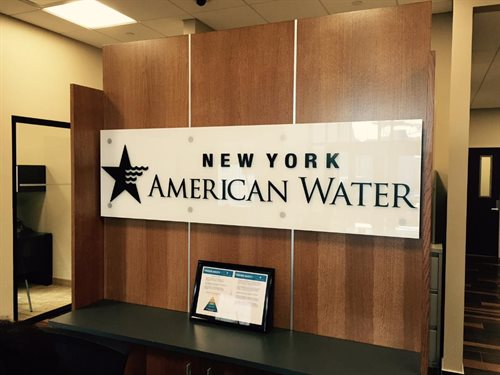 "New york water, Utlity company Sign with Glass and standoffs 1/4"" backsprayed white glass with 1/4"" plexiglass acrylic , Water jet cut , Painted black"