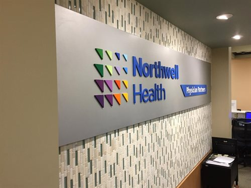 "Northwell health logo Brushed aluminum panel, 1/4"" thick  laser cut acrylic logo painted muliple pms colors  Installed  Incorporated Village of Island"